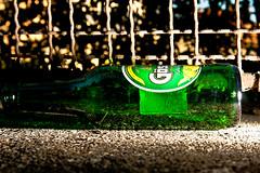 Used (Nicolas Pavlidis) Tags: beer fence bottle flash used bier lying blitz zaun flasche gsser greengrn liegend benutzt