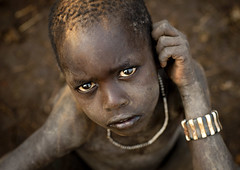 Bodi boy in Ethiopia (Eric Lafforgue) Tags: poverty eyes sad artistic harvest culture tribal ornament hunger drought tribes bodypainting tradition tribe ethnic rite tribo famine adornment pigments ethnology bodi tribu eastafrica thiopien etiopia ethiopie etiopa 3700 bodis  etiopija ethnie ethiopi  etiopien etipia  etiyopya  nomadicpeople         peoplesoftheomovalley