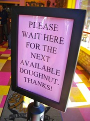 Please wait here for the next available doughnut