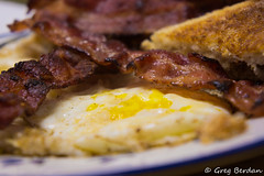 Bacon or the egg - Explored (Greg Berdan) Tags: blue food brown white yellow breakfast bacon toast plate eggs odc2 ourdailychallenge