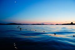 Croatian evening mood (marin.tomic) Tags: travel blue sunset sea reflection silhouette island evening coast nikon europe waves mood horizon croatia more moonlight bluehour croazia croacia adriatic gettyimages sibenik hrvatska jadran dalmatia dalmacija kroatien vodice dalmatien d40