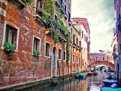 beautiful brick entrance off a Venice canal (slcook52 (Sylvia)) Tags: travel bridge venice houses vacation urban italy brick texture architecture boat canal colorful gondola selectivefocus copyrightedallrightsreserved sylviacookphotography