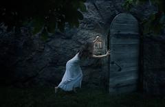 The girl and the secret within (Jenny Jacobsson) Tags: door light portrait lamp girl grass stone wall dark gate secret lantern gown tiptoe nightgown sneak nightie