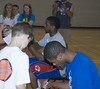 Ben McLemore and Thomas Robinson sign autographs