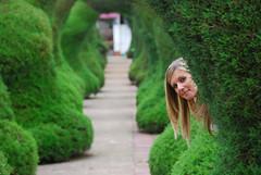 Peeking (Brian Sloane) Tags: park parque green bush costarica arch amy shrub zarcero