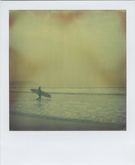 Surf (Lizzie Staley) Tags: sea summer england film beach sport relax polaroid sx70 seaside sand surf waves surfer surfing devon instant expired woolacombe 2011 artistictz roidweek2011