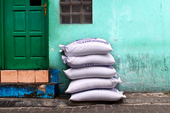 five bags of... rice? (f i  a s) Tags: street red abstract male green wall canon island photography israel photo paint rice south sudan capital cyan gas un terror terrorism bags lpg flour maldives petroleum flotilla firas cannister juba eos500d uniquemaldives firax fias httpfirasssblogspotcom flytilla