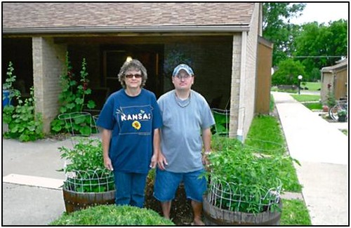Kirkendall Heights, located in Ellsworth, Kan., developed new whiskey barrel gardens.  Residents Betty Jo and Eric are proud to show off their new gardens.