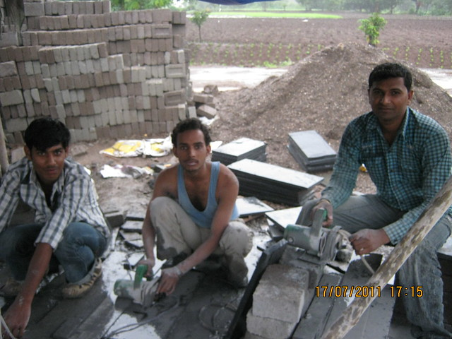 Tile cutters working on Sunday evening at Mont Vert Vesta Urawade Pirangut Pune 412 108