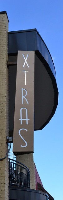 Xtras Sign