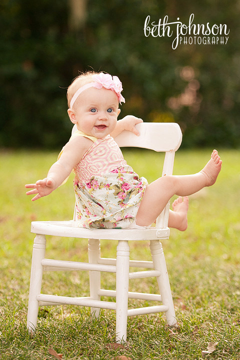 nine month old baby girl in chair at maclay gardens