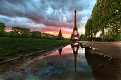Reflections on the Eiffel Tower (Stuck in Customs) Tags: world park city travel sunset urban paris france tower water metal seine digital reflections french puddle island photography blog high iron europe ledefrance republic dynamic stuck state district capital eiffeltower july engineering eiffel icon structure historic reflected photoblog software latoureiffel champdemars processing western romantic imaging northern region range iconic arrondissement 7th metropolitan hdr tutorial trey rivegauche travelblog customs greenspace rpubliquefranaise 2011 ratcliff rgionparisienne hdrtutorial stuckincustoms treyratcliff ladamedefer photographyblog stuckincustomscom nikond3x