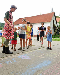 X10_6402 (neonzu1) Tags: party summer people man art vertical rural children fun countryside chalk community hungary village mayor drawing humor ground humour celebration event together judge beret pinafore pinny cooperation buli housecoat somogy eventphotography zselic gálosfa otthonka otthonkafesztivál otthonkanap otthonkafestival otthonkaday otthonkaparty