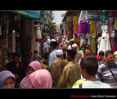 Crowded Friday (jean-marc rosseels) Tags: street people men colors canon indonesia women crowd hijab shops friday surabaya canon7d