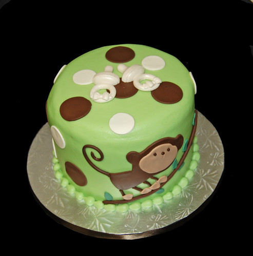 green and brown monkey baby shower cake for twins 2 pacifiers