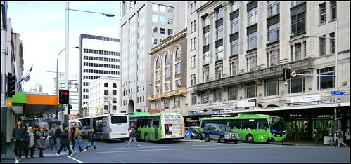 Pedestrian and buses on Custom St