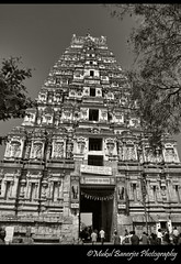 Virupaksha temple gopuram, Hampi Karnataka(BW) (Mukul Banerjee (www.mukulbanerjee.com)) Tags: sculpture india art heritage history tourism beautiful statue festival stone architecture temple photography photo ancient nikon indian traditional tourist unescoworldheritagesite unesco worldheritagesite photographs idol temples historical pooja tradition dslr shiva karnataka hindu archeology mythology 14thcentury puja hampi worldheritage southindia vijayanagar d60 sigma1020mm northkarnataka shivling tungabhadra historicalindia krishnadevaraya nikond60 vijayanagara shivlinga 7thcentury virupakshatemple indianheritage achyutaraya shivaling vijayanagarkingdom bymukulbanerjee mukulbanerjee ©mukulbanerjee mukulbanerjeephotography ©mukulbanerjeephotography wwwmukulbanerjeecom ©wwwmukulbanerjeecom