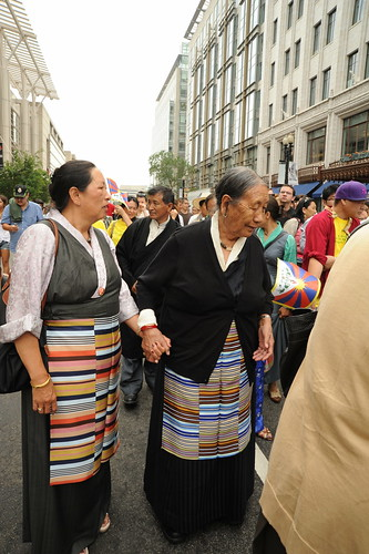 Tibetan women holding hands parade for World Peace with Tibetan Flags, near Verizon Center where Kalachakra is being given by His Holiness the 14th Dalai Lama, Washington D.C., USA by Wonderlane