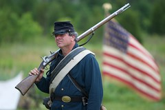 Soldier at Rest (Brian Utesch (shutterBRI)) Tags: usa america canon soldier war gun pennsylvania flag military union rifle americanflag pa gettysburg civilwar american battlefield reenactment starsandstripes warfare 2011 shutterbri brianutesch