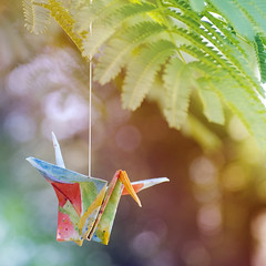Colorful Crane (Brandi Miller) Tags: pink blue red orange color tree green bird water yellow project watercolor paper one for flying wings rainbow community origami colorful branch bokeh crane branches cranes string hanging tied mimosa deviantart fella hang paperfolding 1000 thousand folding