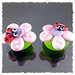 Green & pink earring with red & black ladybug