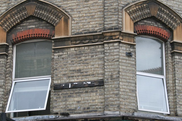 Ribbon of a role of film on a house in Kilburn