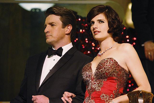 Castle and Beckett very dressed up, arm in arm