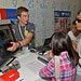 Google Science Fair 2011 Finalist, Christopher Nielsen from Calgary, Alberta, Canada explains his project to visitors.