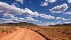 Arizona Strip, Clayhole Route, Uinkaret Volcanic Field (darthjenni) Tags: trip travel vacation arizona nature rock stone clouds landscape outdoors utah aperture hike trail geology formations ptlens geological coloradoplateau mohavecounty olympuse510 colorefexpro30 dfine20 olympuszuikodigitaled1442mmf3556 sharpenerpro30 viveza2