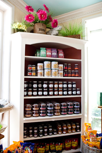 Shelf full of jams, Tate's cookies and baking mixes