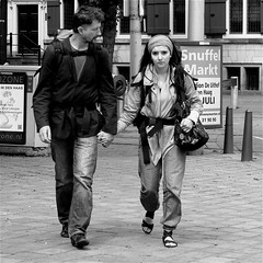 HOLD MY HAND (Akbar Simonse) Tags: street people urban bw woman man holland netherlands monochrome beauty square eyes couple zwartwit candid streetphotography denhaag tourists luggage holdinghands buitenhof thehague streetshot straat rucksacks straatfotografie straatfoto straatfotograaf akbarsimonse