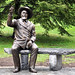 "Apollos ""Paul"" Smith. Life-size cast bronze. Paul has shared a bench with passersby outside the Paul Smith's College Administration Building since early May. Artist: Deron Wright."