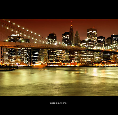 nyc newyorkcity newyork skyline brooklyn night skyscraper downtown cityscape manhattan financialdistrict brooklynbridge highrise newyorkskyline hudsonriver empirestatebuilding redsky lightreflection newyorkatnight brooklynbridgepark shobeiransari