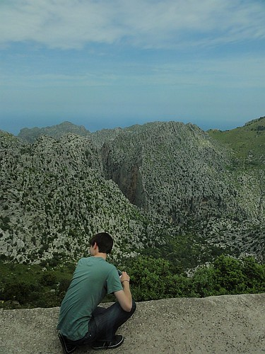 Tourist taking in limestone scenery in Mallorca