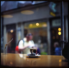 Lonely Espresso (NyYankee) Tags: 120 6x6 film cup mediumformat lights sweden stockholm bokeh gamlastan oldtown kodakportra160vc pentaconsixtl espressohouse autaut carlzeissjenabiometar80mmf28
