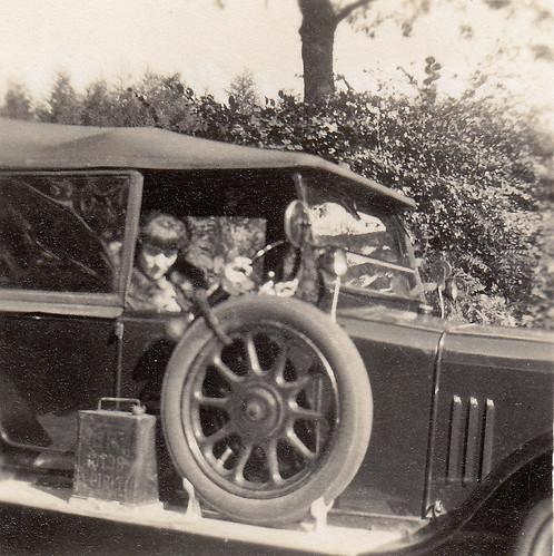 Woman in car. 1920s.