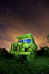 Dump Truck ([Nocturne]) Tags: longexposure nightphotography blue chris light summer sky lightpainting green abandoned graveyard night clouds truck canon stars star photo big rust exposure paint cheshire wheels large trails machine rusty dump jim lp vehicle pm wreck busted derelict lunar crusty nocturne starry luminaries startrails nightexposure luminary machinary lpp noctography chrisbenbow 5dmkii wwwnoctographycouk