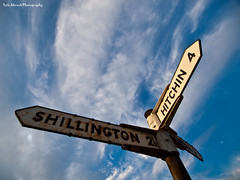 Sign of the Times (Rafe Abrook Photography) Tags: blue cloud sign olympus directions roadsign e3 hitchin cirrus shillington pirton