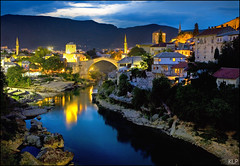 Nightfall over Mostar (katepedley) Tags: world longexposure bridge blue heritage rock stone night canon river lights evening war europe mostar bosnia tripod unesco most hour herzegovina limestone 5d restoration balkans peninsula eastern 1740mm yugoslavia stari balkan polariser  slavic