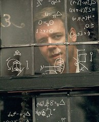 Russell Crowe looks out a window covered in scribbled math.