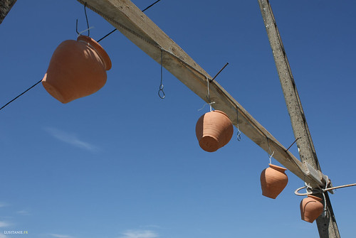 Clay pots suspended, waiting to be broken ...