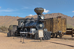 The Reno, Coal Locomotive (Jim Purcell) Tags: usa arizona az pimacounty tucson oldtucsonstudios transportation transport railroad railway coalpowered locomotive noon winter wintertime bridge lightroom photomechanic hdr highdynamicrange tonemapping photoshop topaz adjust denoise detail remask handheld multipleexposure photograph digital dslr pentax pentaxk20d zoom smcpentaxda1650mm28edalifsdm train railwaylocomotive trainengine locomotiveengine sunlight sunny business capitalism commerce enterprise mercantilism trade media moviestudio photomatix