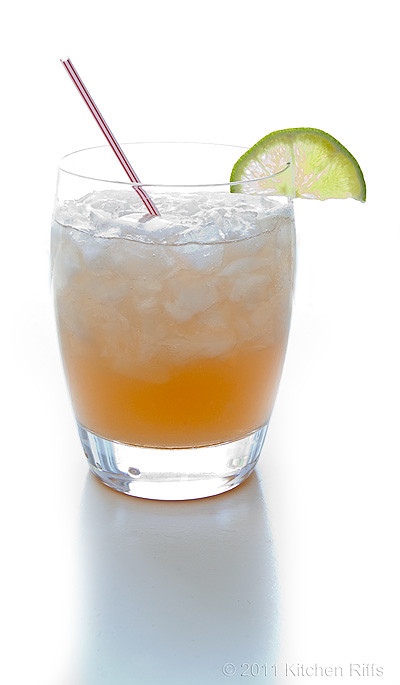 Mai Tai with lime garnish and cocktail straw