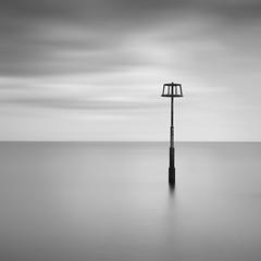 Marker Post, Pembrokeshire (Weeman76) Tags: uk longexposure sea bw seascape monochrome wales mono nikon minimal le pembrokeshire minimalist amroth d90 markerpost nd110 sigma1770mmf284dcoshsm niksoftsilverefexpro2