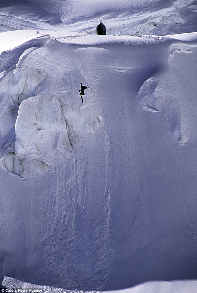 Going downhill... fast! Free skier takes amazing 600-feet leap off mountain cliff face  1