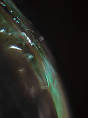 Cosmic Edge (jaxxon) Tags: light shadow abstract blur macro glass dark lens prime nikon focus bokeh space micro fixed abstraction 28 365 mm specular nikkor emerald cosmic highlight cosmos f28 vr afs 105mm 105mmf28 2011 d90 nikor project365 f28g gvr jaxxon 105mmf28gvrmicro ayearinpictures 190365 nikkor105mmf28gvrmicro nikon105mmf28gvrmicro jacksoncarson