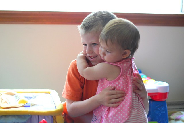 Makenna giving Benjamin a hug