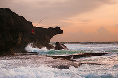 Young Fisherman [Explored] (Meljoe San Diego) Tags: boy sunset sea sky seascape clouds fisherman nikon rocks waves philippines young handheld splash nikkor pangasinan d300 2470mm bolinao rockview meljoesandiego