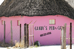 Candy's Pub (cowyeow) Tags: poverty africa street old pink silly bar weird town crazy pub funny village sad candy african empty funky wrong prostitution alcohol badsign booze rough decrepit namibia funnysign dilapidated brothel rundown hotpink namibian candys uglybuilding funnyname ruacanafalls ruacana crapsign funnyafrica