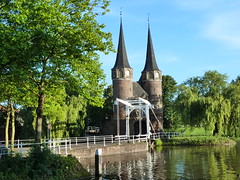 Delft - The Oostpoort (amy's antics) Tags: trees water fence reflections canal gate delft oostpoort 0711sh10 onmysummervacationididthis visiteddelft